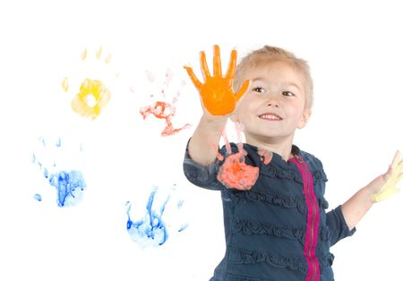 Little girl painting handprints on window, isolated on white background