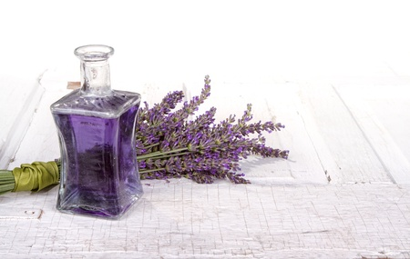 Lavender spa still life with bottle of lavendar infused oil on a vintage door