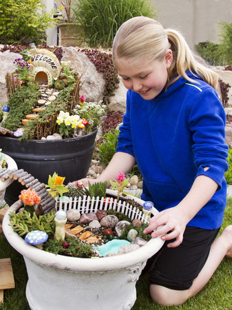Fairy Garden In A Flower Pot With Walking Path Wooden Bridges And