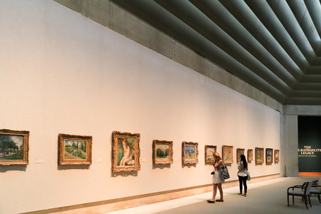 New York, USA - May 22, 2014: Exhibition area inside the Metropolitan Museum of Art. People visit and walk around to see the popular arts in the world.