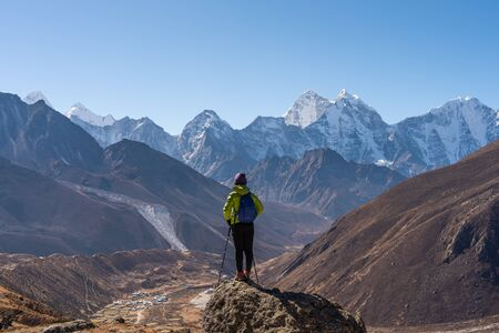 Photo for A trekker standing in front of Himalaya mountain range in Everest region, Nepal, Asia - Royalty Free Image