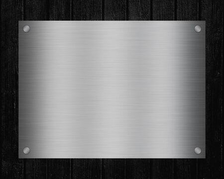 Foto de Shiny metal signboard with copy space for text on black Board background. - Imagen libre de derechos