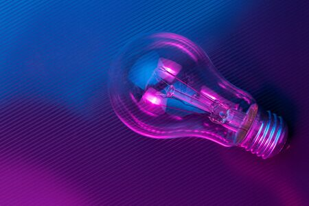 Photo for Photo of light bulb lamp in neon light. Ideea concept. - Royalty Free Image
