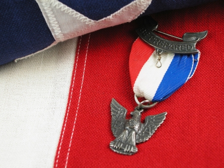 Close up of an Eagle Scout Award sitting on a Flag