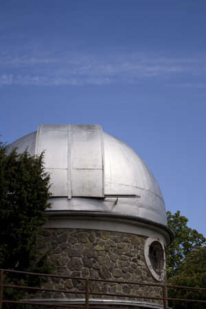 Small observatory and the moon on the background