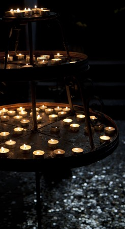 Candle stand in a dark temple