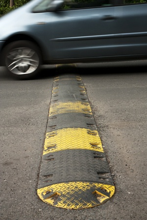 Speed bump on a road when a car is passing