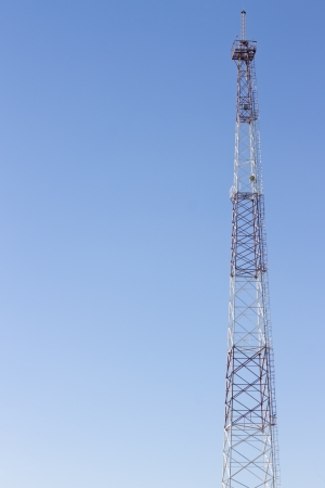 Communication cellular tower on blue sky