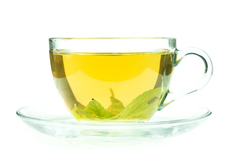 Glass cup of fresh green tea isollated on white background