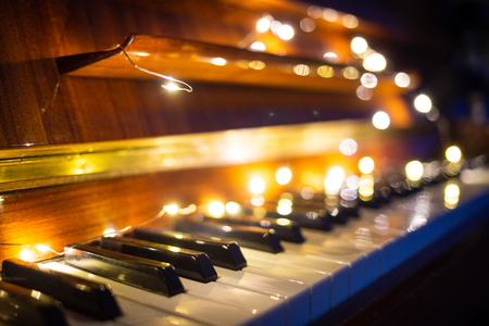 Photo for Piano keyboard with christmas light in the evening - Royalty Free Image