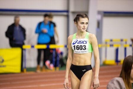 Photo pour SUMY, UKRAINE - FEBRUARY 21, 2020: Oksana Martynova champion in long jump at her attempt at Ukrainian indoor track and field championship 2020. - image libre de droit