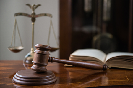 Gavel on wooden table, court room concept