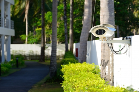 security camera on the fence next to walkway