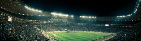 Panoramic photo inside the Soccer City stadium during the 2010 Fifa world cup., with a 'vintage' feel.