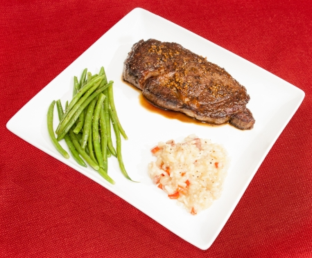 Steak au Poivre with haricots verts and bacon and red pepper risotto