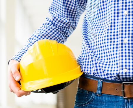 engineer holding a helmet in the hand