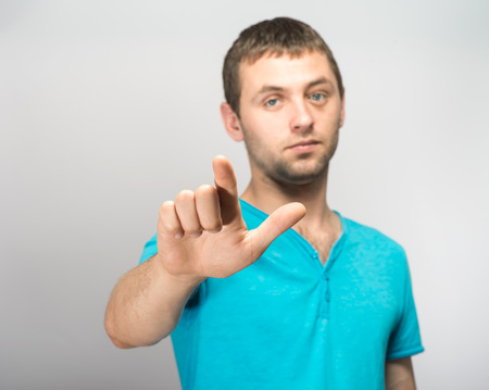young man showing his forefinger