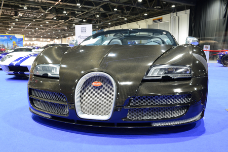 DUBAI, UAE - NOVEMBER 18: The Bugatti Veyron sportscar is on Boulevard of Dreams on Dubai Motor Show 2017 on November 18, 2017