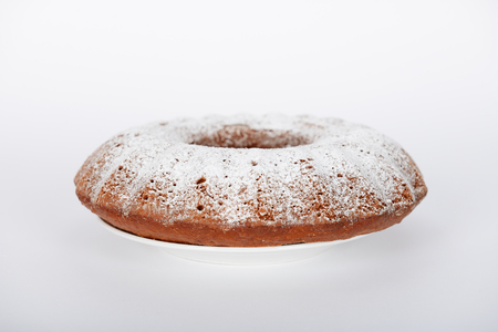 Photo pour The hand-made cake with white sugar powder on it - image libre de droit