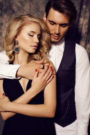Photo pour fashion studio photo of beautiful sensual couple in elegant clothes - image libre de droit