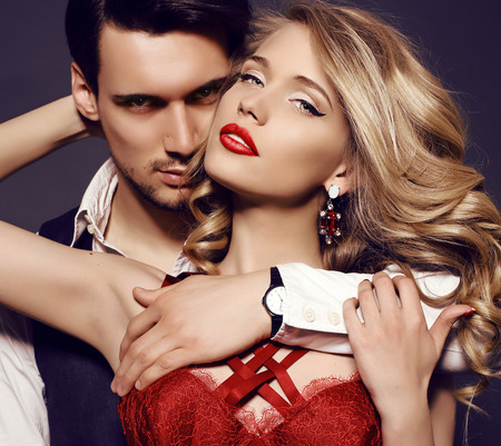 Photo pour fashion studio photo of beautiful sensual couple in elegant clothes - image libre de droit