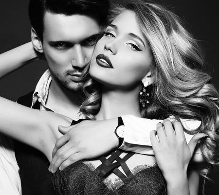 Photo for black and white fashion studio photo of beautiful couple, wears elegant clothes, embracing each other - Royalty Free Image