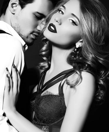 Foto de black and white fashion studio photo of beautiful couple, wears elegant clothes, embracing each other - Imagen libre de derechos