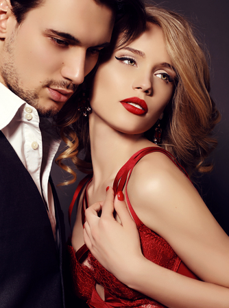 fashion studio photo of beautiful couple, wears elegant clothes, embracing each other