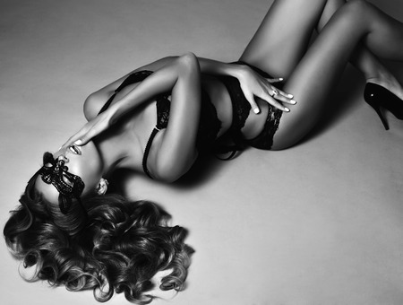 Photo for fashion black and white studio photo of beautiful sexy woman with long blond curly hair wears elegant lingerie and lace mask on face - Royalty Free Image