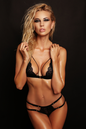 Photo for fashion studio photo of gorgeous sexy woman with blond hair wears luxurious lace black lingerie - Royalty Free Image