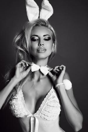 Foto für fashion studio black and white photo of gorgeous sexy woman with blond hair in lingerie dress, with bunny ears headband - Lizenzfreies Bild