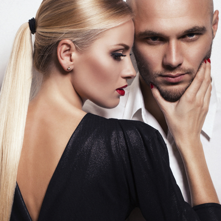 Photo for fashion studio photo of impassioned couple. gorgeous woman with blond hair posing with handsome man - Royalty Free Image