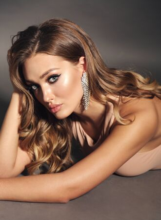 Photo pour fashion studio photo of beautiful sensual woman with blond curly hair in elegant clothes - image libre de droit