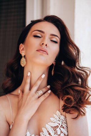 Foto de fashion studio photo of beautiful woman with dark hair in luxurious dress with jewelry - Imagen libre de derechos