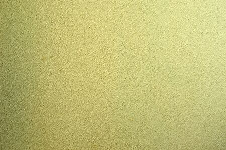 Photo pour old wall plastered with cement and painted yellow - image libre de droit