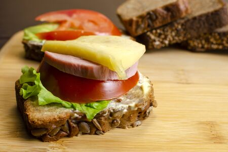 Photo pour tasty sandwiches with vegetables, cheese and meat close-up, healthy eating concept - image libre de droit