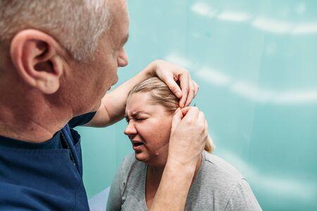 Foto de man s ear with needles closeup acupuncture concept - Imagen libre de derechos