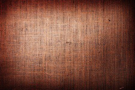 Photo pour Fragment of rough brown textile background - image libre de droit