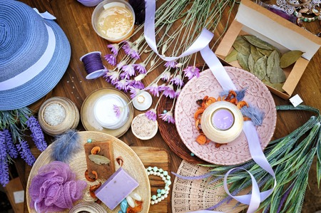 Flat lay spa and fashion accessories, handmade artisan soap, fresh flowers, wisp of bast, candles, bath salt etc.