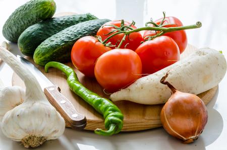 Fresh vegetables lying on a cutting board