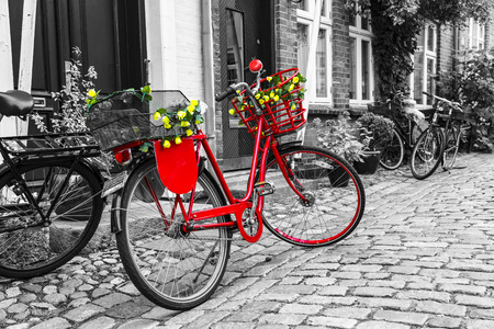 Foto de Retro vintage red bicycle on cobblestone street in the old town. Black And White Toned. Ribbe, Denmark - Imagen libre de derechos