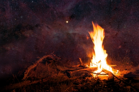 abstract night sky with many stars and camp fire- elements of this image furnished by NASA