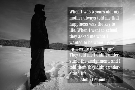 Quote of the famous american singer John Lennon over the black and white landscape with man stand in winter land