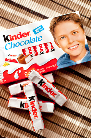 DORKOVO, BULGARIA - MARCH 20, 2017:Kinder chocolate bars on  wooden background.Kinder bars are produced by Ferrero founded in 1946.