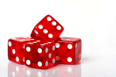 Stack of red and white dice on an isolated white background