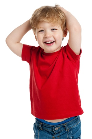 Smiling happy boy in red T shirt  shot in the studio on a white background.