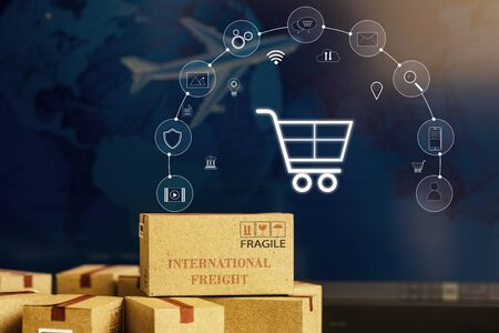 Photo pour Paper boxes on notebook with icon customer network connection. Depicts transportation, international freight, global shipping, overseas trade, regional, or local forwarding. - image libre de droit