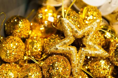 Many Christmas balls and star in golden sequins colorful Christmas xmas Background