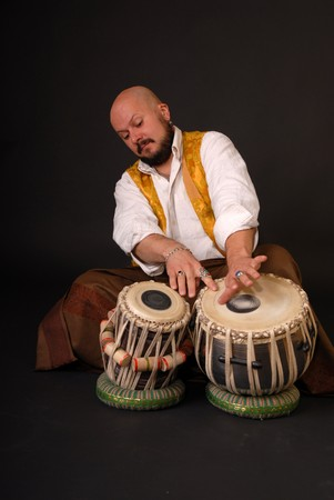 Musician with oriental tabla drums