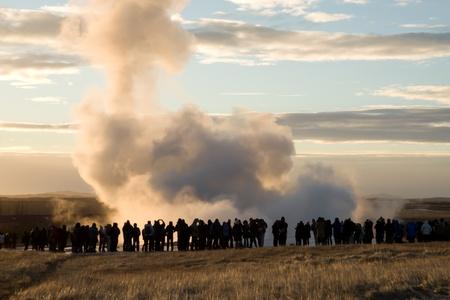Tourists watching Strokkur geysir